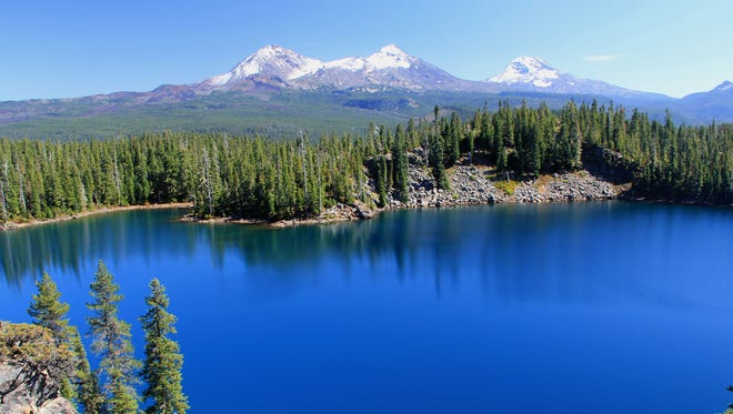 View of the Three Sisters above Benson Lake in the Mount Washington Wilderness.