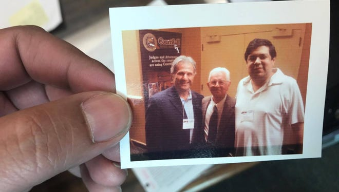 94th District Judge Bobby Galvan keeps a picture with the late Justice Jack Pope in his office.