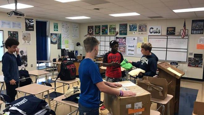 Seneca High School student volunteers help pack boxes of t-shirts to send to Hurricane Harvey victims. Seneca, SC