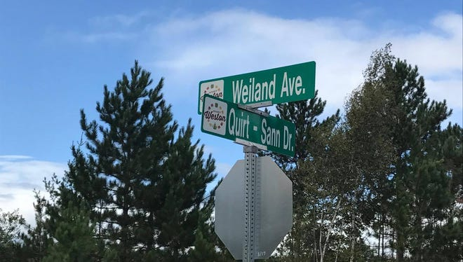 Street signs have been erected in honor of those who lost their lives on March 22 in a new development off of Birch Road in Weston, constructed by PGA Plumbing.