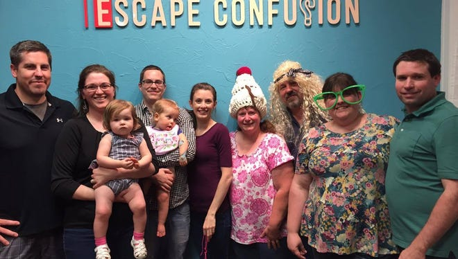 The eight partners in Escape Confusion pose in their location on 12 Carlisle Street, Hanover. From left to right: Mark Wherley, Megan Wherley, Quinn Wherley, Steve Lyter, Thea Lyter, Emily Lyter, Chris Wolfe, Mike Wolfe, Jennifer Wiles and David Wiles.