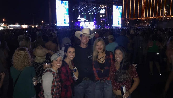 (Left to right) Chrisanna Roberts, Amy Moore, Kevin Moore, Alicja Wolny, Christina Zambrana attend the Route 91 Harvest Festival, the night of the deadliest mass shooting in modern U.S. history.
