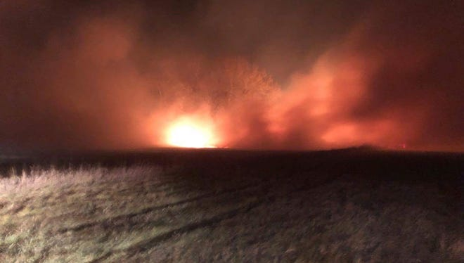 Fire fighters and ranchers battled a wildfire in 20 to 40 MPH winds between Harlem and Fort Belknap Tuesday night.