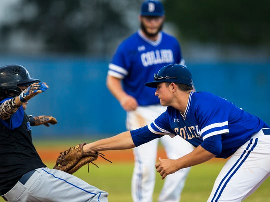 Barron Collier first baseman Nick Denove, right, tags Matt McGarty out during the game against Ida Baker on Tuesday, May 16, 2017 in Naples, Florida.