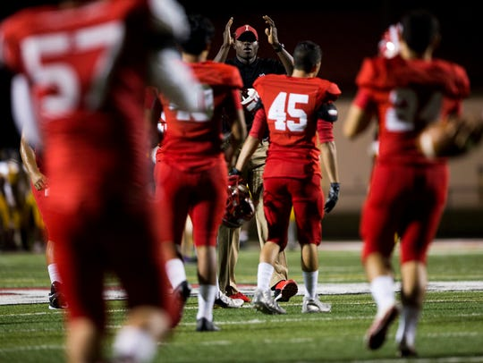 Immokalee's Rodelin Anthony, center, coaches his players
