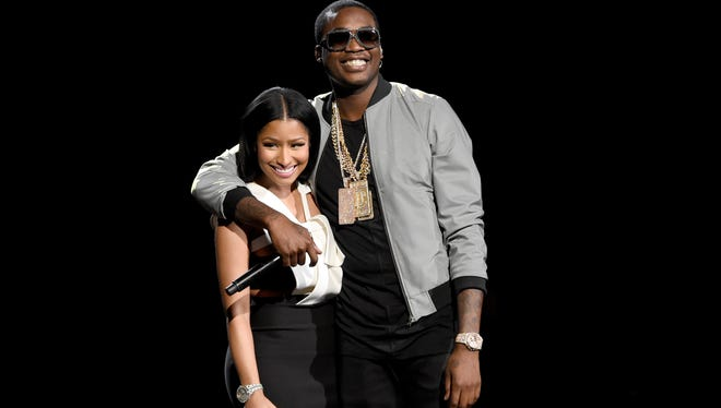 Nicki Minaj, left, and Meek Mill embrace after a performance at the BET Awards Sunday night.
