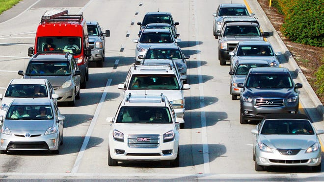 Traffic flows Thursday along Corkscrew Road in Estero. Traffic has become a headache for officials and residents alike and efforts are underway to solve it.