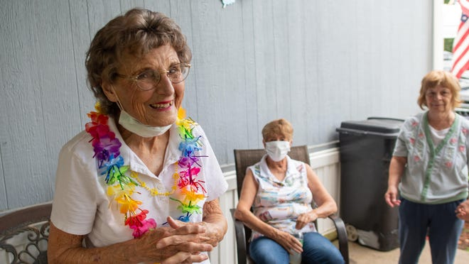 Lois Rosevelt, left, smiles Monday outside her home surrounded by friends and family. Rosevelt turned 91 Monday and lived through the attack on Pearl Harbor while growing up in a Navy family.
