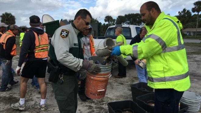 Collier County Sheriff's Office corporal Rob Capizzi helping at a recent clean-up.