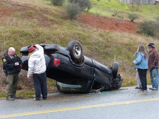 A motorist rolled his pickup on Cascade Boulevard north of Redding on Monday. A Shasta County sheriff's official said weather was a factor in the crash.