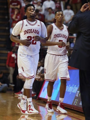 Indiana's Stanford Robinson, left, and Troy Williams, back from four-game suspensions, come off the court during Indiana University's 78-64 win over SMU at Assembly Hall in Bloomington on Nov. 20, 2014.