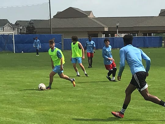 Lansing United's Lewis Jones looks to push the ball