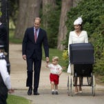 Prince William, Duchess Kate, Prince George and Princess Charlotte in the pram walk to baby's christening at St Mary Magdalene Church at Sandringham on June 5, 2015. It was the first time the four Cambridges had been pictured all together.in public.