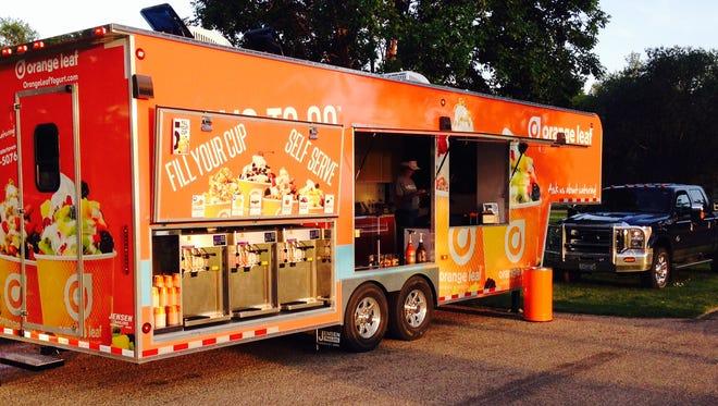 Orange Leaf mobile frozen yogurt trailer.