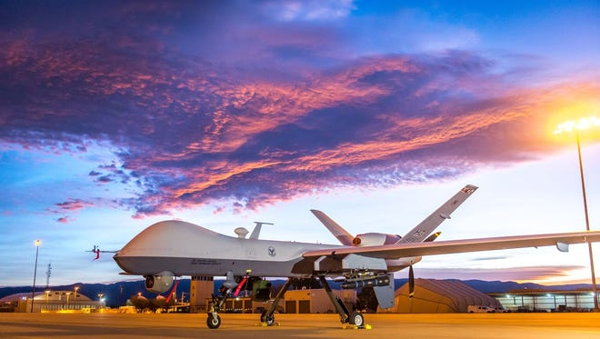 The sun rises over an MQ-9 Reaper remotely piloted aircraft at Holloman Air Force Base, N.M., Dec. 16, 2016. The 49th Aircraft Maintenance Squadron supports the 6th Reconnaissance Squadron as well as the 9th and 29th Attack Squadrons, enabling the graduation of pilots and sensor operators in support of the Air Force's largest formal training unit. Additionally, Airmen with the 49th AMS continuously deploy in support of intelligence, surveillance and reconnaissance requirements.