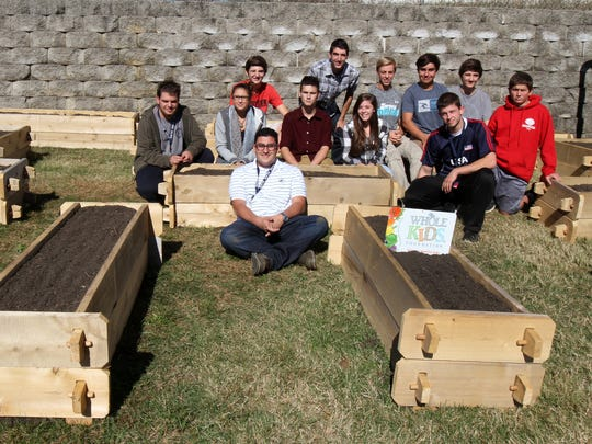 Middletown High School South environmental club poses in the new student-run garden, which received a $2,000 grant for the garden and will produce food for a local food bank.