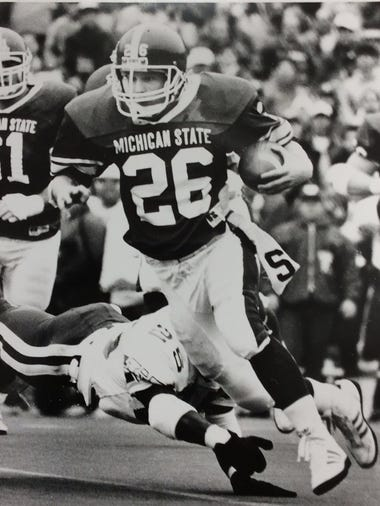 MSU tailback Blake Ezor avoids a tackle by Wisconsin