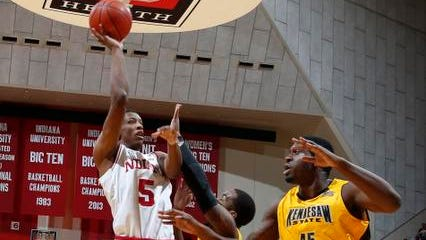 Dec 22, 2013; Bloomington, IN, USA; Indiana University Hoosiers forward Troy Williams (5) shoots against Kennesaw State Owls forward Andrew Osemhen (45) at Assembly Hall. Mandatory Credit: Brian Spurlock-USA TODAY Sports