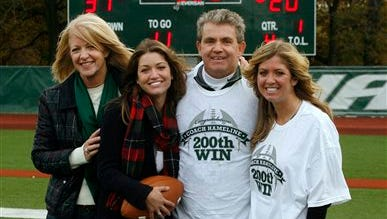 In this photo taken on Nov. 6, 2010 and released by Wagner College, Wagner football coach Walt Hameline, second from right, pose with his family, from left, wife Debi, daughters Kelly and daughter Kristin, after earnings his 200th career win after defeating Monmouth 31-20 in a college football game in the Staten Island borough of New York. You think fall weddings are inconvenient for college football fans? Imagine being a coach with a daughter who has her heart set on a Saturday in late September. That was Hameline's dilemma, when his youngest daughter, Kelly, told him last fall the place she chose as the site of her big day had few dates available, and the one she picked was Sept. 20, the same day Wagner was scheduled to play Monmouth University. With the help of an old friend, Hameline was able to reschedule the game.