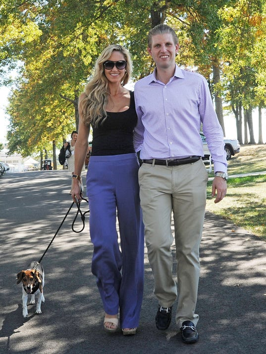 Eric Trump and Lara Yunaska with a dog