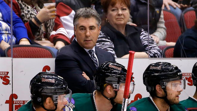 Arizona Coyotes coach Dave Tippett stands on the bench during the second period of his team's NHL hockey game against the Calgary Flames on Friday, Nov. 27, 2015, in Glendale, Ariz. The Coyotes defeated the Flames 2-1 in overtime for Tippett's 500th coaching victory in the NHL.