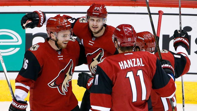 Arizona Coyotes' Oliver Ekman-Larsson (23), of Sweden, celebrates his goal against the Los Angeles Kings with Max Domi (16), Martin Hanzal (11), of the Czech Republic, and Anthony Duclair (10) during the second period of an NHL hockey game Saturday, Jan. 23, 2016, in Glendale, Ariz.