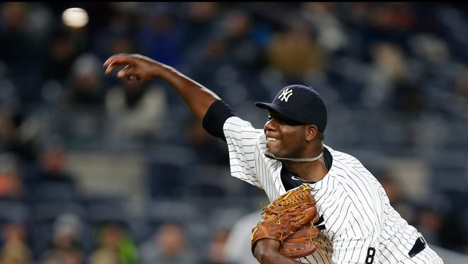 New York Yankees starting pitcher Michael Pineda (35) delivers in the second inning of a baseball game against the Houston Astros in New York, Wednesday, April 6, 2016. Pineda allowed a first-inning, solo home run to the Astros Carlos Correa, and a grand slam to the Astros George Springer.