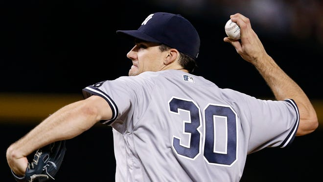 New York Yankees' Nathan Eovaldi throws a pitch against the Arizona Diamondbacks during the fourth inning of a baseball game Wednesday, May 18, 2016, in Phoenix.