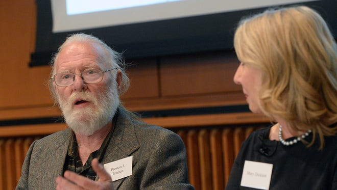 """In this Monday, Oct. 3, 2016 photo, panelist Preston Truman, a lifelong downwinder activist, speaks at the launch event for """"Downwinders of Utah Archive"""" at the J. Willard Marriott Libray at the University of Utah, in Salt Lake City. Playwright Mary Dickson, whose 2007 play """"Exposed"""" chronicled the effects the above ground nuclear tests had on the downwind population in Utah is at right.  The new University of Utah archive about the state's """"downwinders"""" features oral histories, photographs and newspapers clippings documenting the impact of nuclear testing during the 1950s in Nevada."""