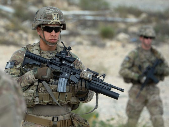 In this photograph taken on Aug. 30, 2015, US soldiers part of NATO patrol during the final day of a month long anti-Taliban operation by the Afghan National Army (ANA) in various parts of eastern Nangarhar province,  at an Afghan National Army base in Khogyani district.  President Barack Obama on October 15, 2015 announced thousands of US troops will remain in Afghanistan past 2016, retreating from a major campaign pledge and acknowledging Afghan forces are not ready to stand alone.