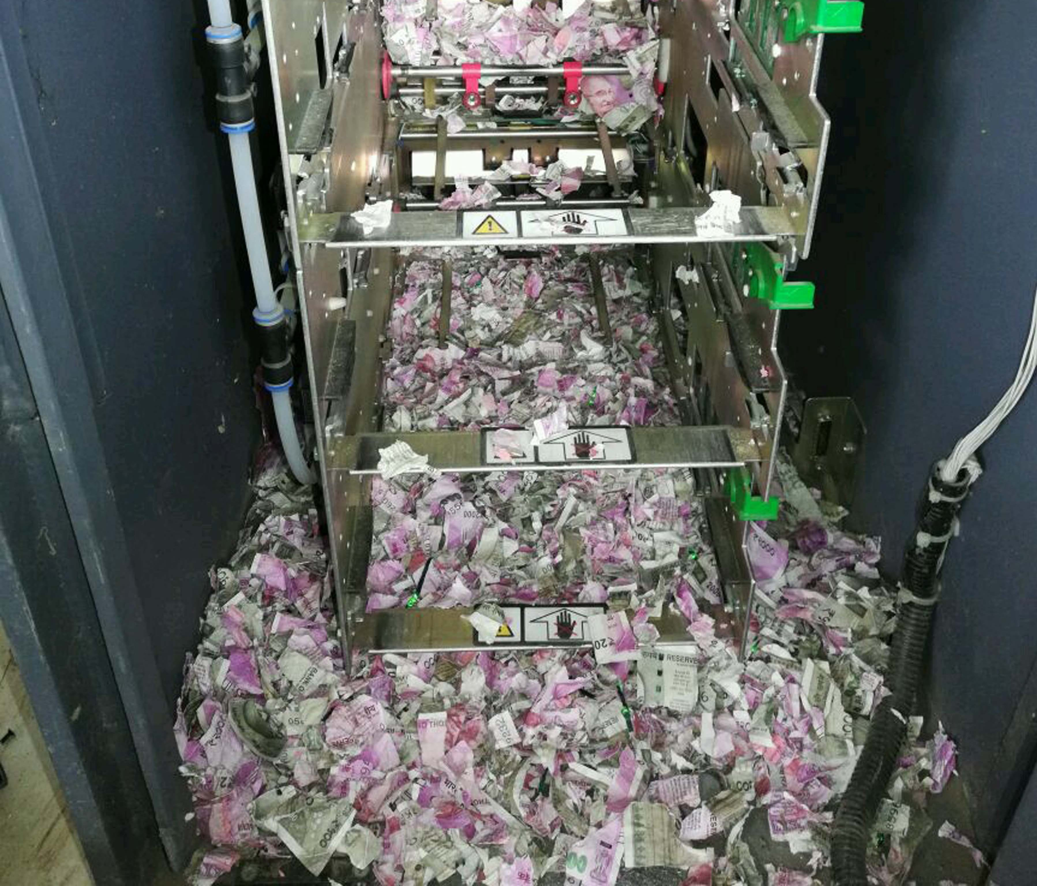This picture taken on June 19 shows shredded Indian currency notes in 2000 and 500 rupee denominations after being eaten by at least one rat in at ATM in Tinsukia in India's northeastern Assam state.    Indian police on June 21 said rats nibbled throug