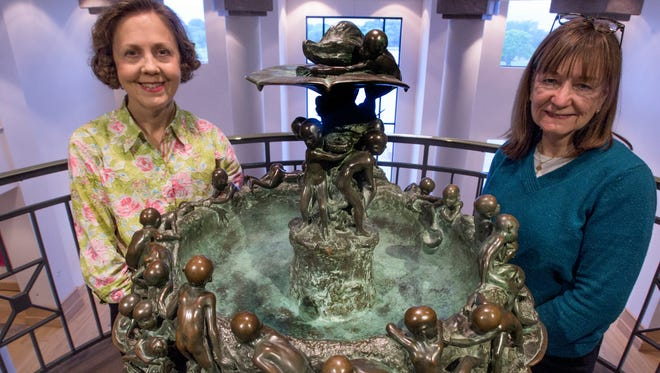 Pam Bransford, left, and Margaret Lynne Ausfeld pose with the Flimp Fountain at the Montgomery Museum of Fine Arts in Montgomery, Ala. on Friday May 5, 2017. The fountain was the inspiration for the Flimp Festival held yearly at the museum.