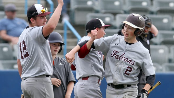 Jake Rivera of Albertus Magnus is congratulated after scoring during the  Section 1 Class B baseball championship against Edgemont at Dutchess Stadium in Fishkill May 27, 2017.  Albertus Magnus crushed Edgemont 12-0 to win the sectional title.