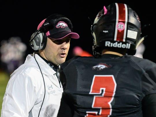Bellevue head coach Brett Wesner speaks with Gino Costello