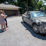 Damage to a garage near the intersection of West Springettbury and Cleveland in York after a car was stolen and chased by police Tuesday July 19, 2016.