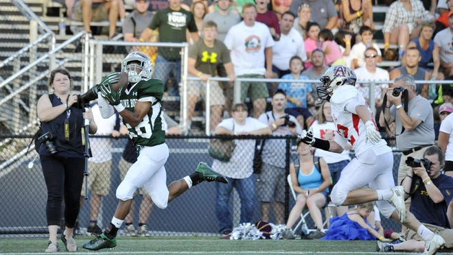Vermont running back Anthony Phillip, left, hauls in a touchdown catch during the third quarter of the Shrine Maple Sugar Bowl at Castleton University on Saturday.