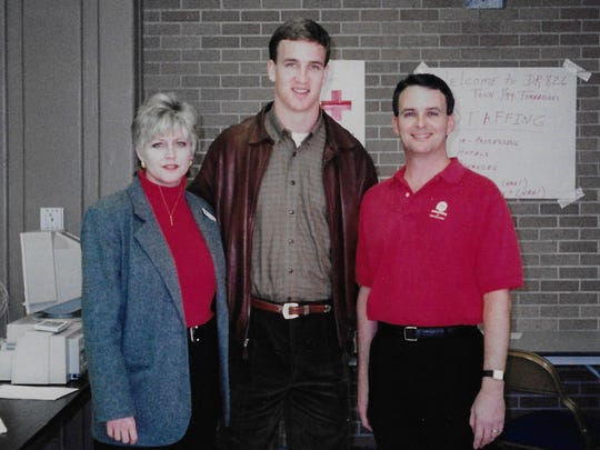 ABOVE: Peyton Manning came to Jackson in January 1999 and presented a check to United Way from the Indianapolis Colts owner. Pictured from left are Wanda Stanfill, the former local American Red Cross executive director; Manning; and former United Way of West Tennessee president Barry Matthews. Manning will speak at a United Way fundraiser in Jackson on Friday.