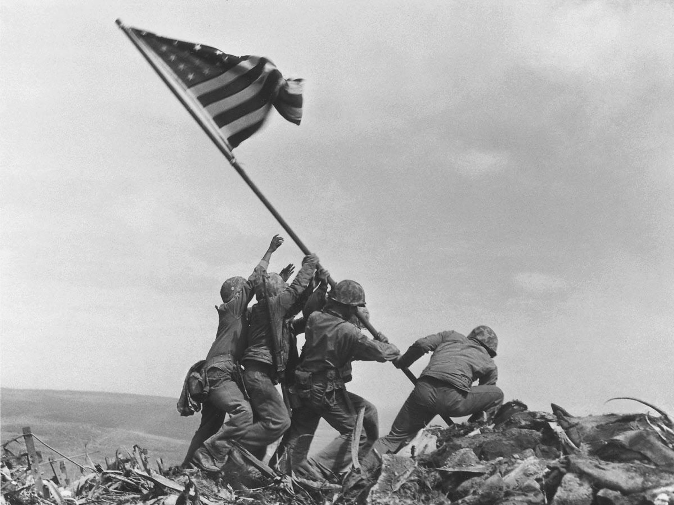 U.S. soldiers on Feb. 23, 1945, raise the American flag atop Mount Suribachi, Iwo Jima, Japan.