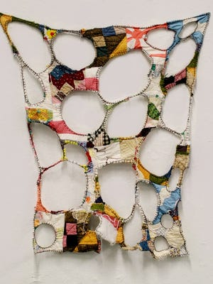 """Arist Colleen Toutant Merrill's """"Deconstructed Mustered up Quilts from Kentucky,"""" which she created by manipulating and re-stitching found quilts and using silk embroidery thread, is part of the exhibit """"Caliker"""" at the Green Building Gallery."""