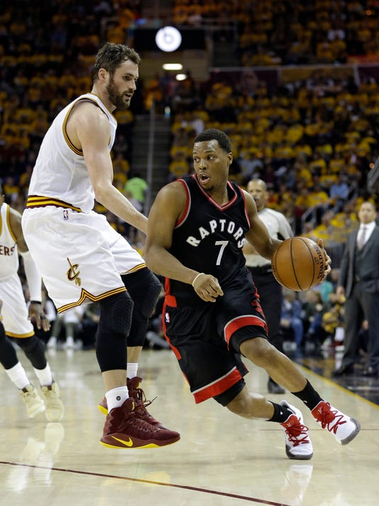 Toronto Raptors' Kyle Lowry (7) drives past Cleveland Cavaliers' Kevin Love (0) in the first half in Game 1 of a second-round NBA basketball playoff series, Monday, May 1, 2017, in Cleveland. (AP Photo/Tony Dejak)