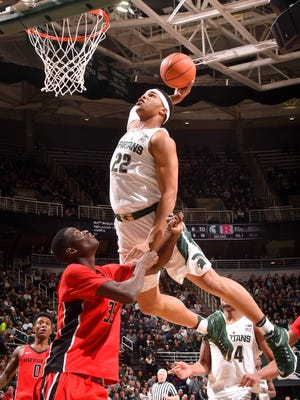 Spartans freshman sensation Miles Bridges skies over Rutgers' Issa Thiam (35) for a tomahawk dunk on a feed from Cassius Winston in the second half as Michigan State beats Rutgers, 93-65, Wednesday night, Jan. 4, 2017, at Breslin Center in East Lansing, Michigan.