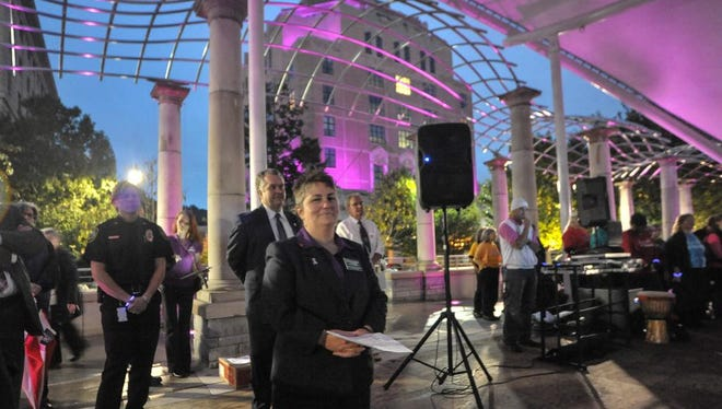 Helpmate executive director April Burgess-Johnson on the stage at the rally to kick off Domestic Violence awareness month in Buncombe County. Asheville City Hall and the Buncombe County Court House will remain purple for the month.