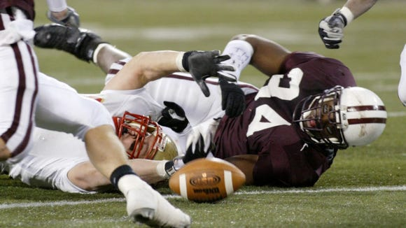 Sometimes I love our photo database archives. This is from 2004 Non-Public 4 final, Ike Garrow (34) for Don Bosco Prep. Garrow was recently named Bosco's new LB coach by coach Mike Teel. The Bergen Catholic player with the ball is Brian Cushing. And yes, it looks like a fumble. Bergen won this game 13-10, their last state title.