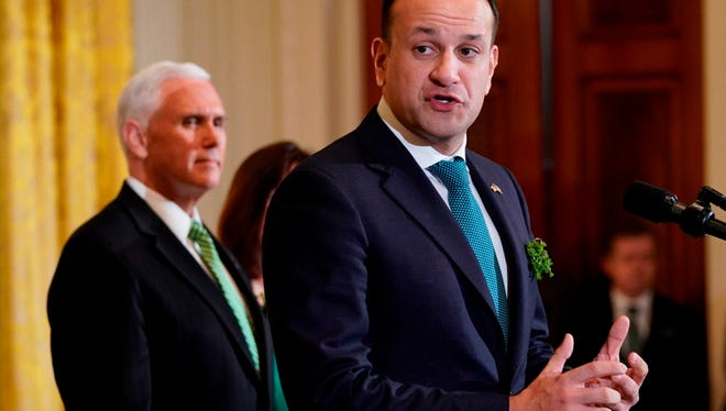 Vice President Mike Pence listens as Ireland's Prime Minister Leo Varadkar speaks before presenting a bowl of shamrocks to President Trump in the East Room of the White House on March 15, 2018.