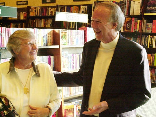 In this 1999 photo, David Harrison, right, chairman of the Sky High For Reading committee, shares a laugh with Sally Carter, Springfield, president of the Retired Teachers Association, prior to a press conference announcing  goals for Sky High On Reading, a literacy campaign Harrison championed.