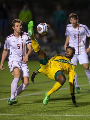 Vermont's Brian Wright attempts a bicycle kick during the Catamounts 2015 NCAA tournament game against Boston College in Newton, Massachusetts.