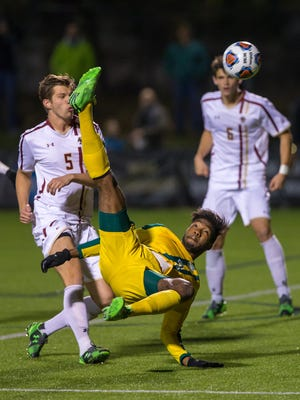 Vermont forward Brian Wright attempts a bicycle kick against Boston College during the teams' NCAA Tournament game in Newton, Massachusetts, on Nov. 19, 2015.