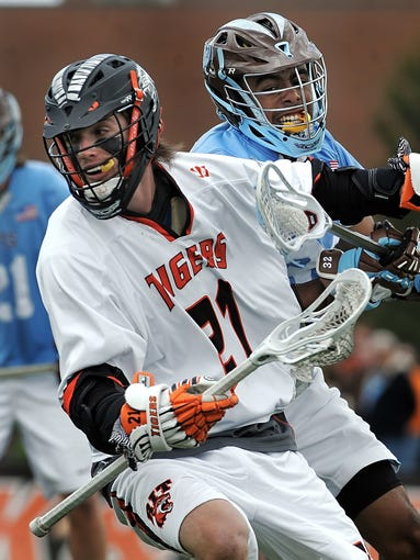 RIT's Casey Jackson, left, shields the ball from Tufts University's Chris Sawyer.