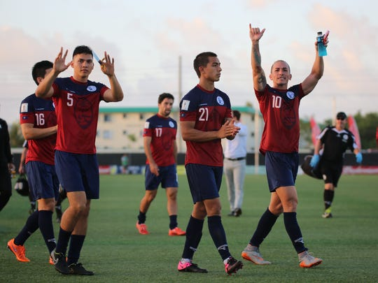 In this Nov. 17, 2015, file photo, members of the Matao acknowledge fans at the Guam Football Association National Training Center following Guam's match against Iran.