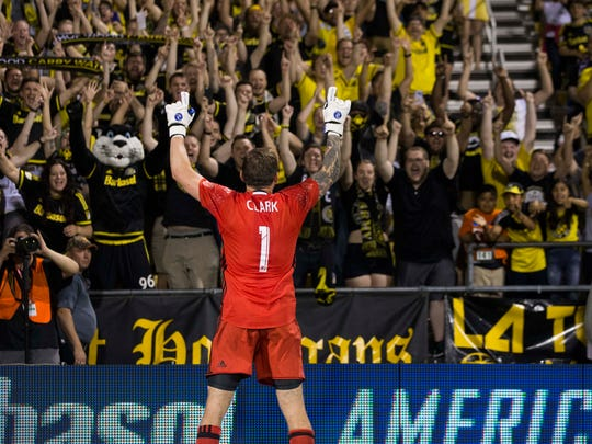 Columbus Crew SC goalkeeper Steve Clark, fro Mason, celebrates with fans after defeating Real Salt Lake at Columbus' MAPFRE Stadium on May 28. Crew SC won the game 4-3. It was Clark's 80th straight MLS start in goal for Crew SC.